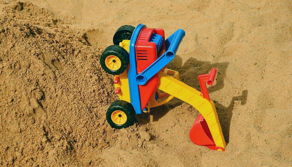 A tipped toy excavator
