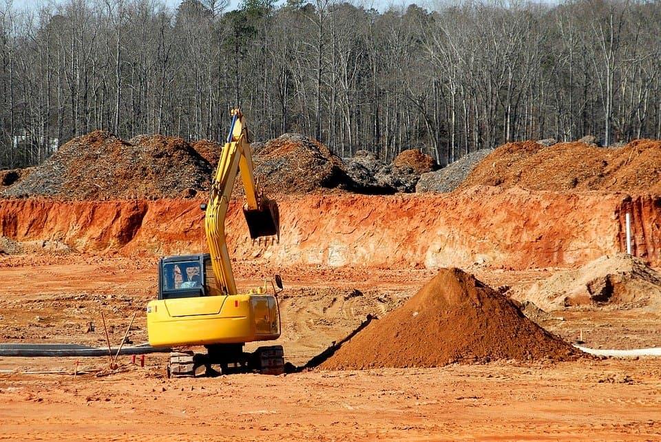 Digging stumps with mini excavators