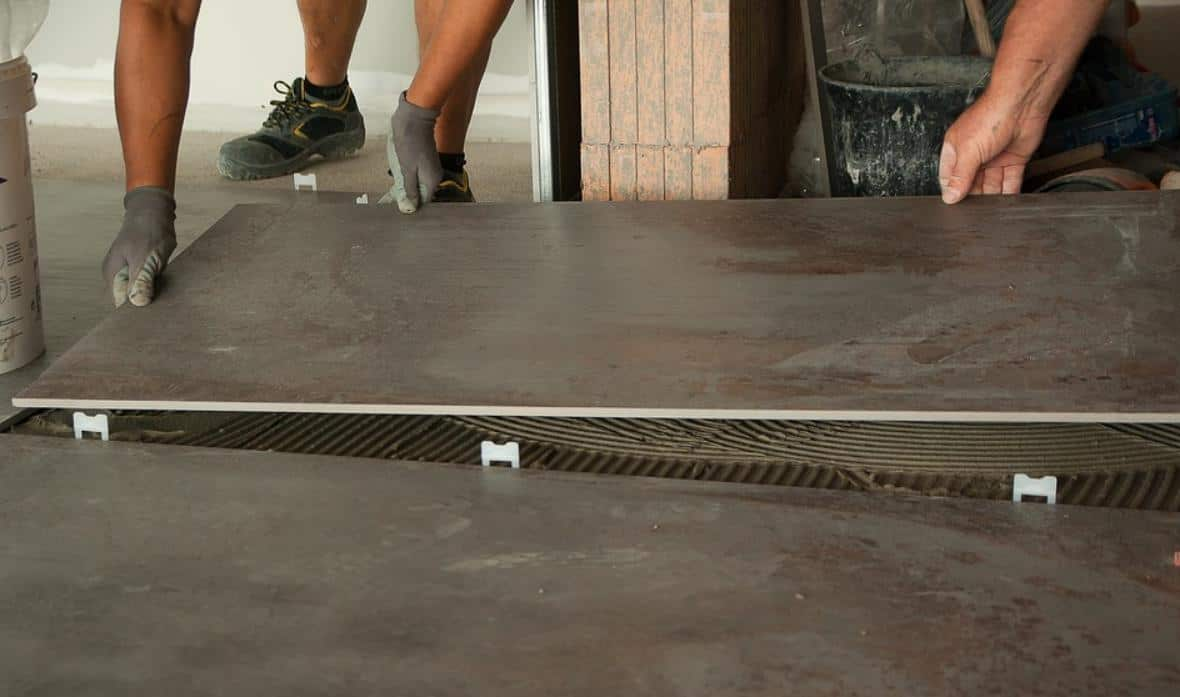 Placing tiles on tile adhesive