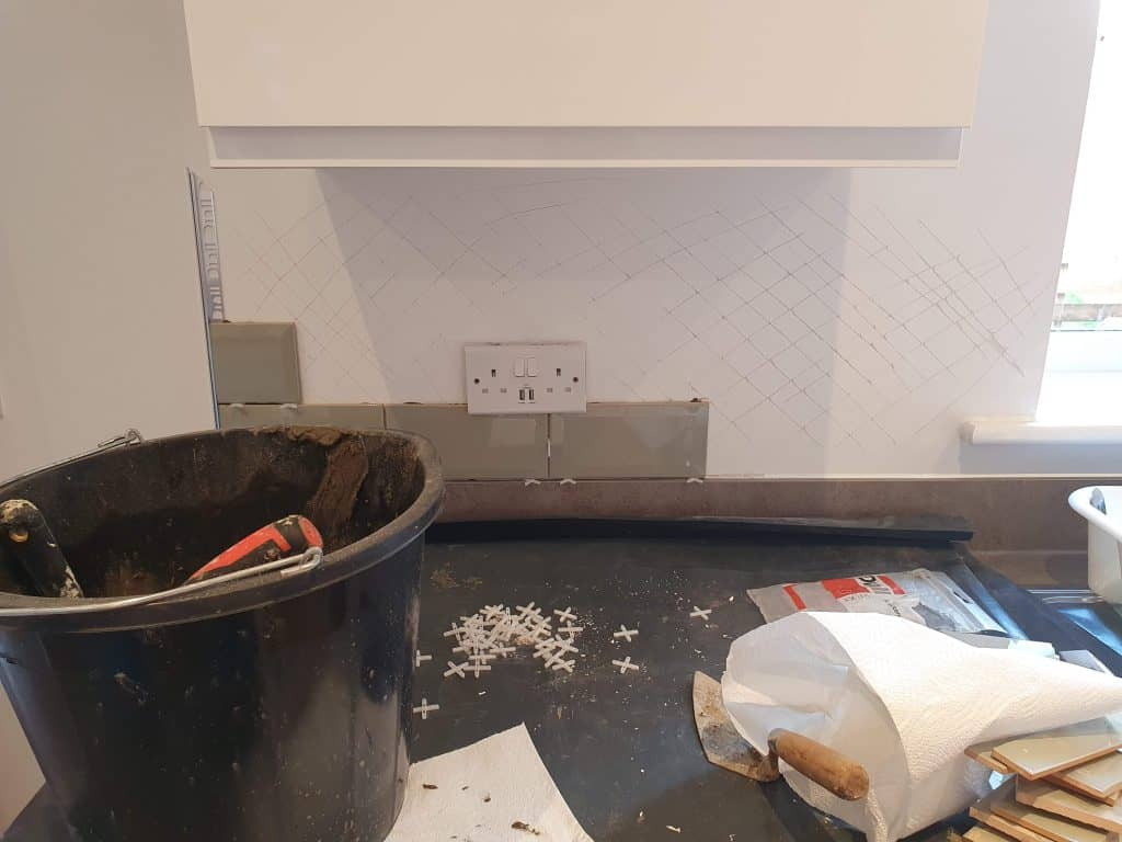 Tiling drywall by scoring the wall first with a knife