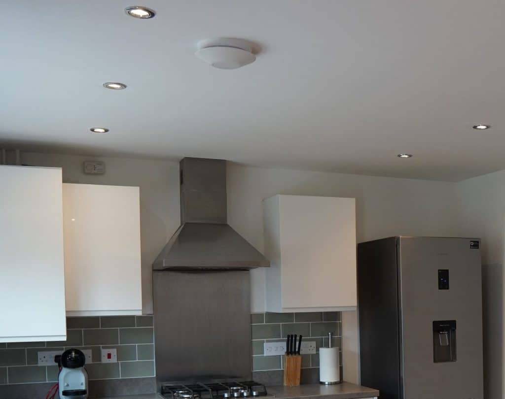 An extractor fan and cooker hood extractor in a kitchen