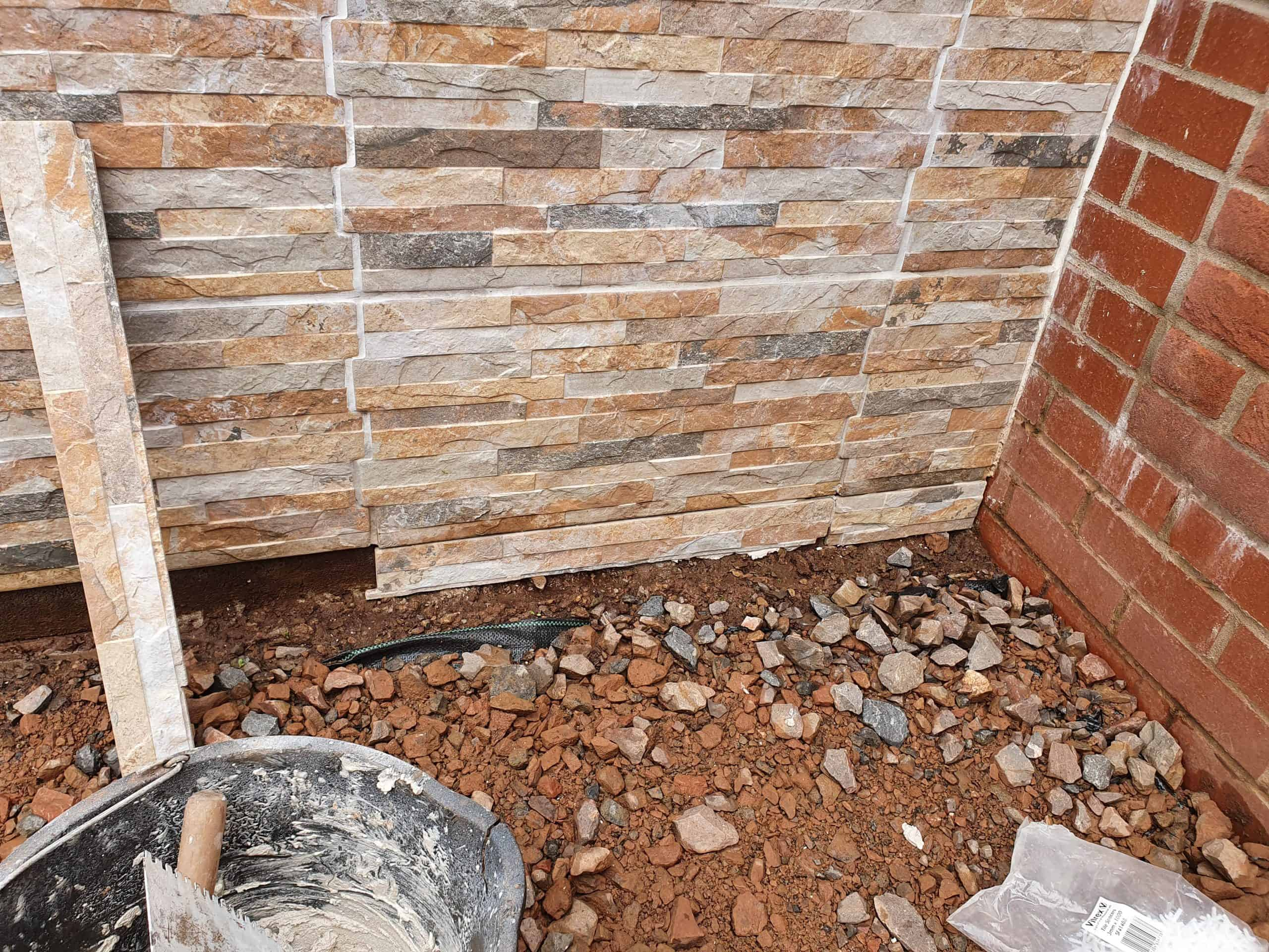 An outdoor tiling project with porcelain tiles and grout