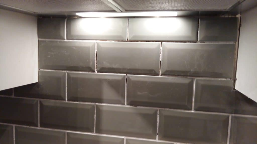 Cracked grout in between some tiles