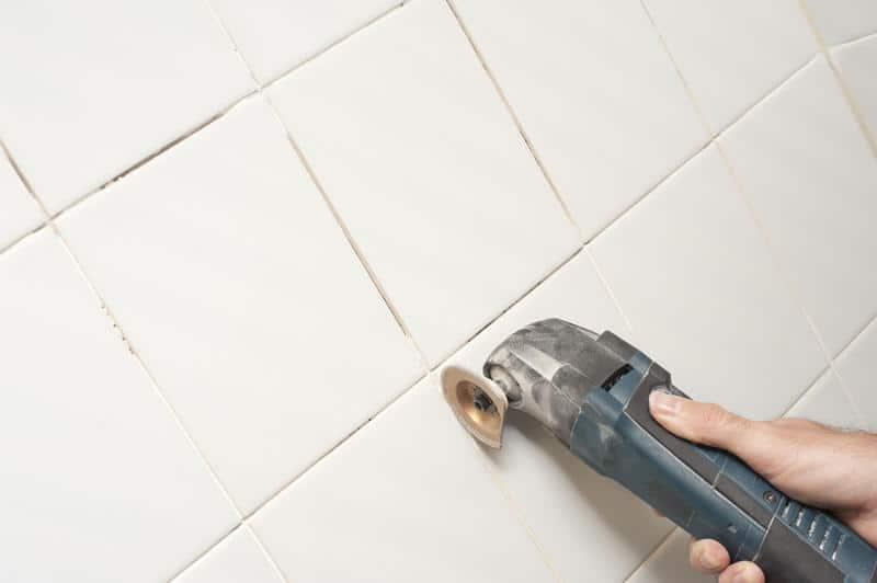 Should I repair drywall before tiling?