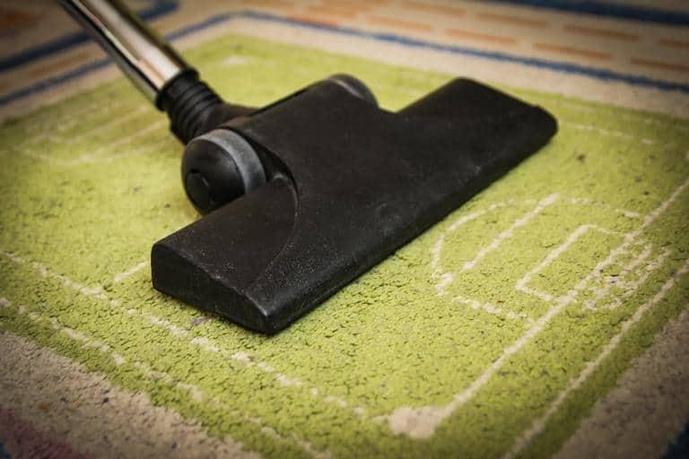 Vacuuming artificial grass