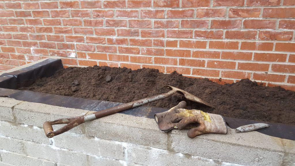 Adding extra soil into a work in progress garden