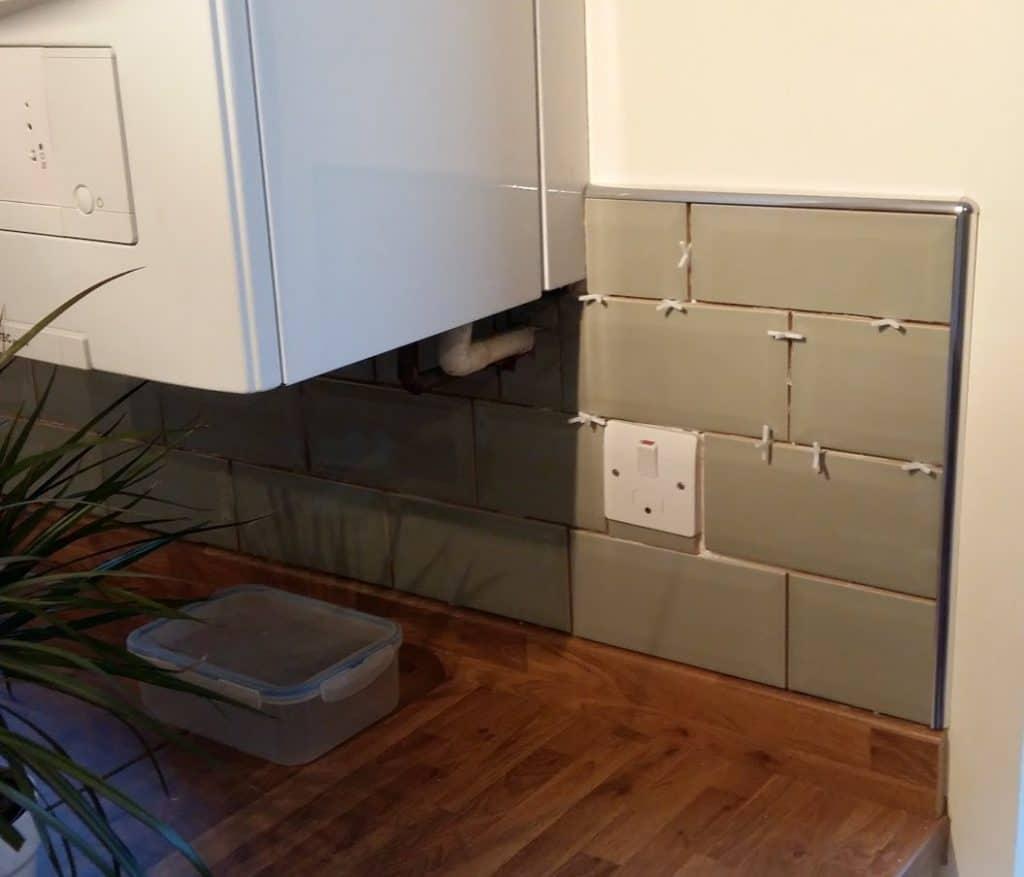 Green metro tiles and metal tile trim