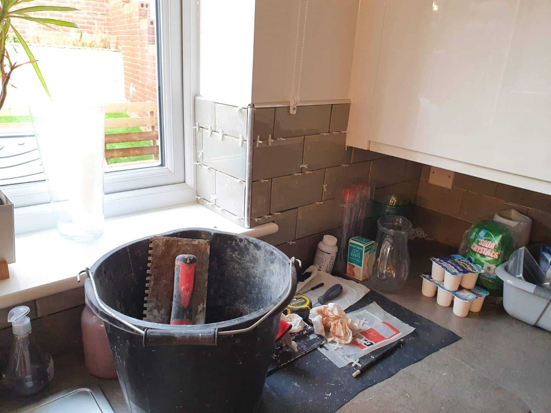 Tiles under and around a kitchen wall cabinet