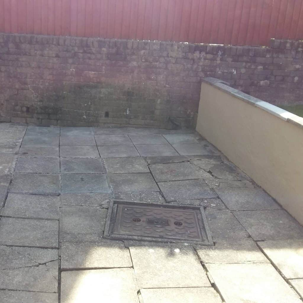 Various pavers which are cracked and sinking