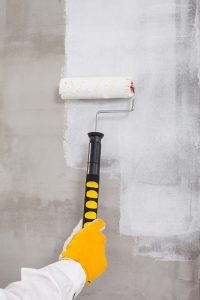 Applying an initial scratch coat to a plaster wall