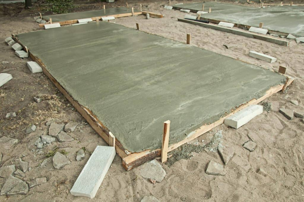 A smaller concrete slab possibly for a garage or outbuilding