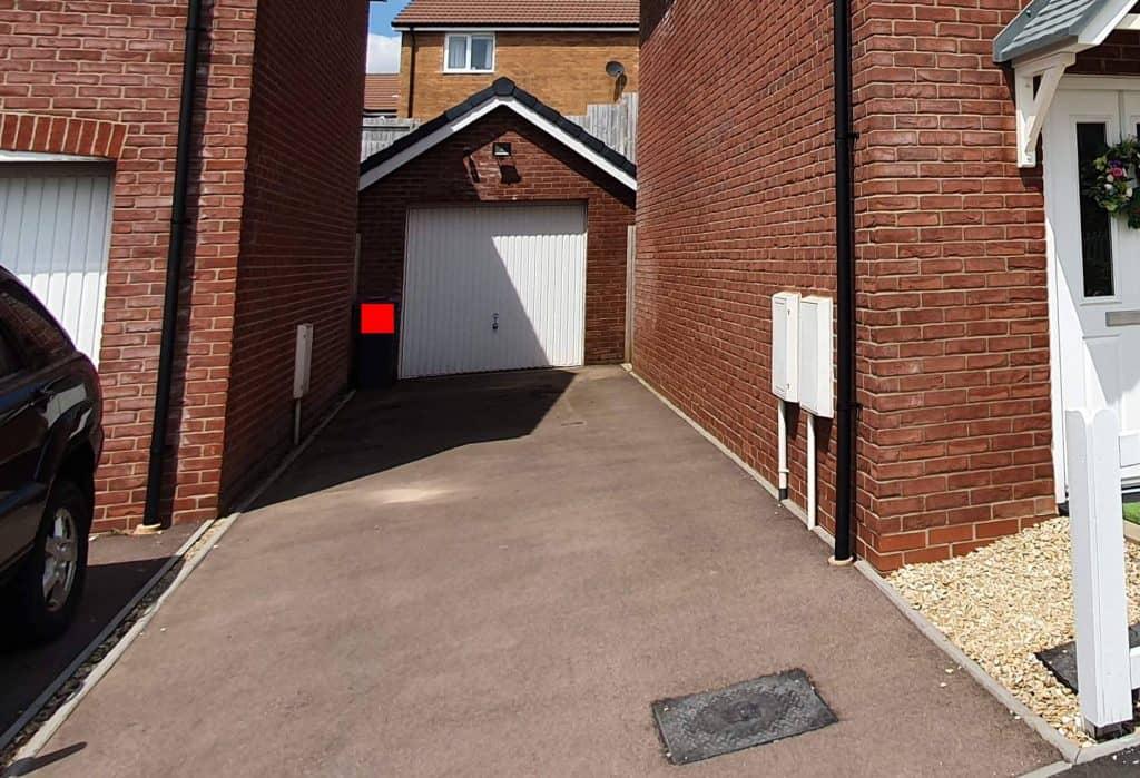 An asphalt driveway in a UK new construction home