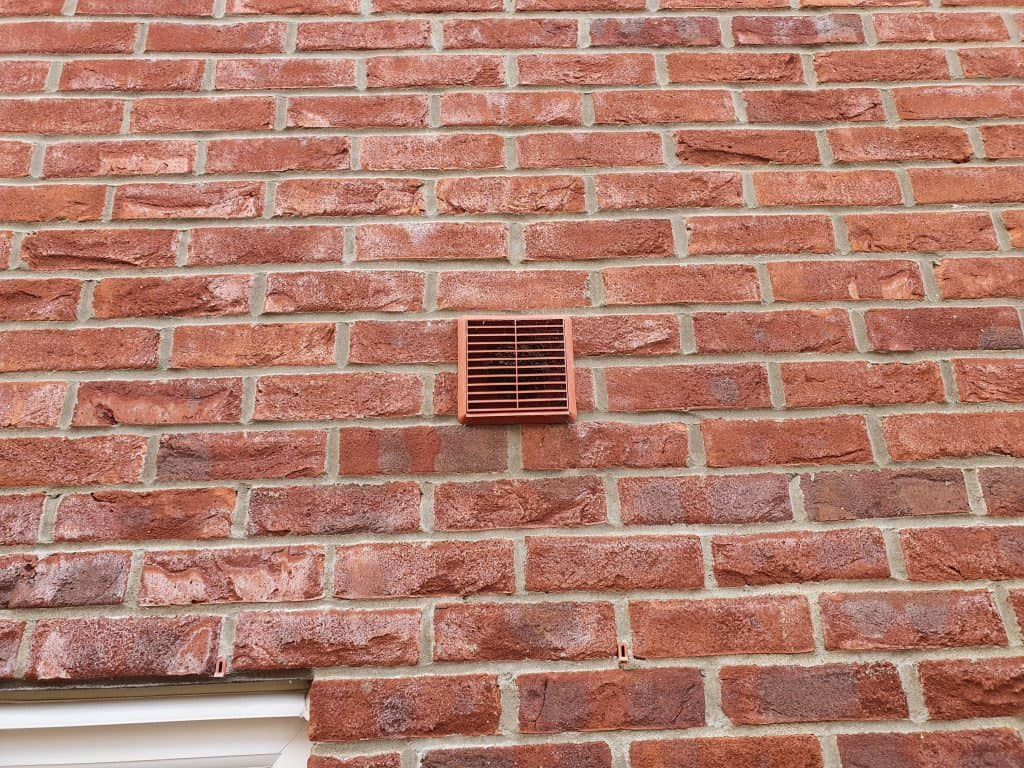 The outside vent showing the houses ventilation ductwork
