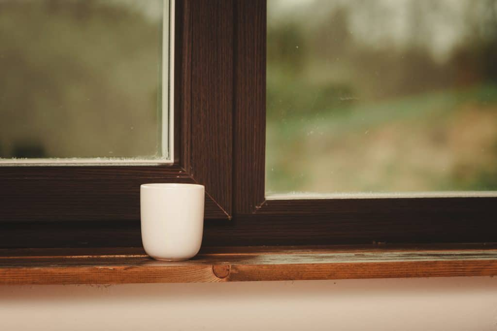 Coffee mug on top of a window sill